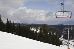 Ski and snowboard slope. With some clouds in the sky and ski lift Royalty Free Stock Photography