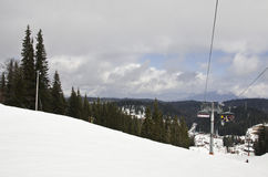 Ski and snowboard slope. With some clouds in the sky and ski lift Royalty Free Stock Images