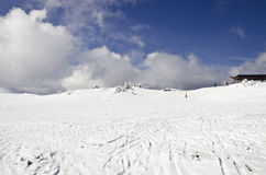 Ski and snowboard slope. Top of the ski and snowboard slope with some clouds in the sky Stock Images