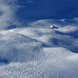 Ski and snowboard tracks and little hut Royalty Free Stock Images