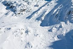 Ski and snowboard tracks on mountain Stock Images