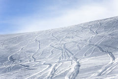 Ski and snowboard tracks on a slope Royalty Free Stock Image