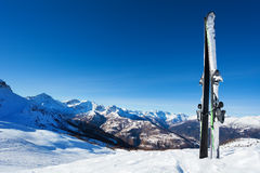Ski stand in snow bank with mountain on background Stock Image