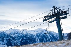 Ski station in the mountains. There is a cable car for skiers. The tops of the snow-capped mountains can be seen Stock Photo