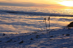 Ski sticks  mountains winter inversion Royalty Free Stock Photos