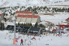 Ski time. Ski resort on a sunny day, montains packed with snow Stock Image