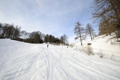 Ski tour slope near alpine hut Royalty Free Stock Image