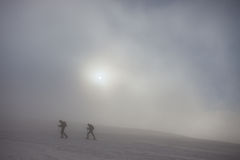 Ski touring on foggy mountain Royalty Free Stock Photos