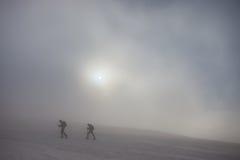 Ski touring on foggy mountain Royalty Free Stock Photos