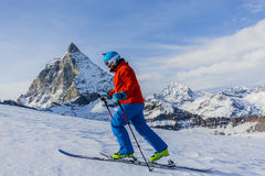 Ski touring man reaching the top in Swiss Alps. Stock Image