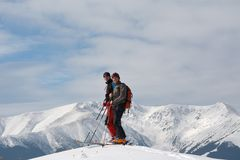 Ski-touring in mountains. Royalty Free Stock Photos