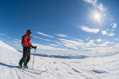 Ski touring on sunny day. Woman looking at the landscape on a ski touring trip Stock Photography
