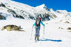 Ski touring in sunny weather. Royalty Free Stock Photo