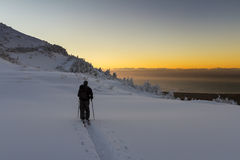 Ski Touring. Sunrise start to an epic day, In the mountains, fresh snow with a blue bird sky. Location Kaikoura, New Zealand Royalty Free Stock Image