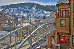 Ski town. Pedestrian bridge in a ski town with a nice condo for people to live, vacation Stock Images