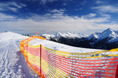 Ski track. Winter mountain landscape with a ski track and safety net Stock Photography