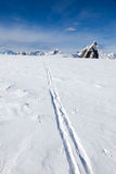 Ski track on fresh snow. Winter sport background with the famous Royalty Free Stock Photo