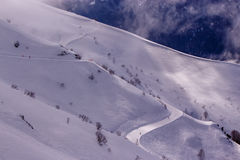 Ski track on mountain slope. Ski track on snowy mountain slope Royalty Free Stock Photos