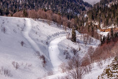Ski track on  mountain slope. Ski track on snowy mountain slope Royalty Free Stock Image