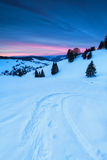 Ski track on snow in mountains at sunrise Stock Image