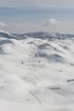Ski track in a snow. Ski track running through snow covered hills Royalty Free Stock Image
