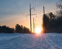 Ski track on snow surface against the rising sun stock photo
