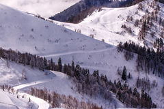 Ski track on snowy mountain slope Stock Photos