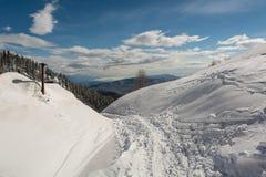 Ski tracks. Running pass chimney into a valley Stock Photos