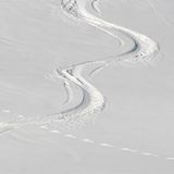 Ski tracks in the powder snow Royalty Free Stock Photos