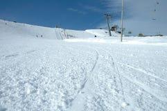 Ski tracks on slope Royalty Free Stock Photo