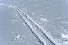 Ski tracks in the snow Royalty Free Stock Image