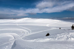 Ski tracks in snow. With blue sky Royalty Free Stock Photos