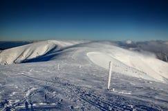 Ski tracks and wooden sticks on Velka Fatra main ridge Slovakia stock photo