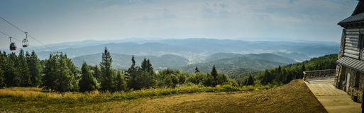 Ski trail in the summer panorama Royalty Free Stock Photo