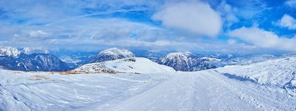 The ski trail on top of Krippenstein mount, Dachstein, Salzkammergut, Austria. Panorama with the ski trail, running to the slope of Krippenstein mount and royalty free stock photography