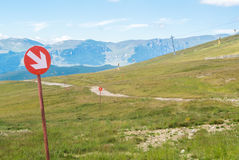 Ski trails at Carpatian mountains on autumn day, red signs with Royalty Free Stock Photography