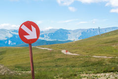 Ski trails at Carpatian mountains on autumn day, red signs with Stock Photography