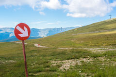 Ski trails at Carpatian mountains on autumn day, red signs with Stock Image