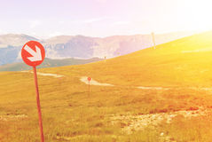 Ski trails at Carpatian mountains on autumn day, red signs with Royalty Free Stock Image