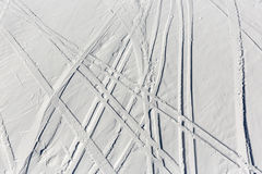 Ski trails off-piste. Ski trails are seen from a aerial view of off-piste ski slope in a mountain top near a ski resort Royalty Free Stock Photo