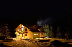 Ski trip. Nice cottage in the mountains Royalty Free Stock Images