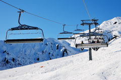 Ski Vacation. Ski lift chairs. Snowcovered high mountain in Alpes. Mayrhofen, Austria Stock Image