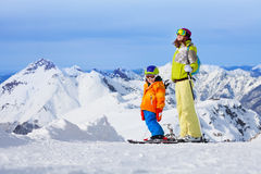 Ski vacation in mountains, woman and child happy Royalty Free Stock Image