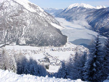 Ski village and frozen lake. The Austrian ski  village of Pertisau and mountain lake Achensee taken from above Royalty Free Stock Photography