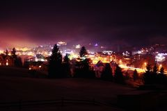 Ski village at night with slope lights, Carpathians royalty free stock image