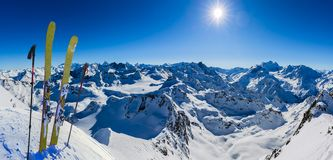 Ski in winter season, mountains and ski touring backcountry equipments on the top of snowy mountains in sunny day, Verbier royalty free stock images