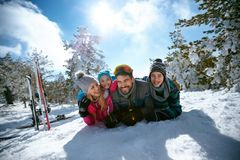 Ski, winter, snow, sun and fun - family enjoying in winter vacat stock photo