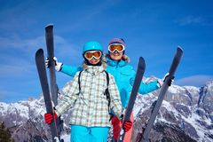 Ski, winter, sun and fun. Ski, winter and fun - Family: mother and daughter enjoying winter vacations Stock Photography