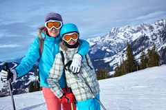 Ski, winter, sun and fun. Ski, winter and fun - Family: mother and daughter enjoying winter vacations Royalty Free Stock Photo