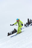 Ski woman turn on slope Royalty Free Stock Images